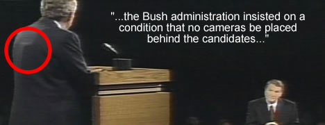 Bush during 1st debate with a mysterious bulge on his back.