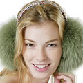 Girl with ear muffs.