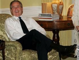 Bush laughing.