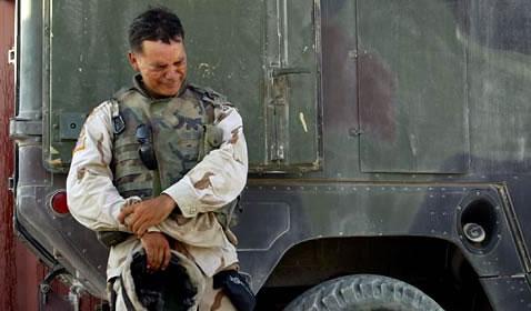 American soldier weeps alone.
