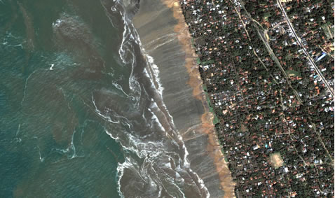 Satellite shot of land damaged by tsunami.