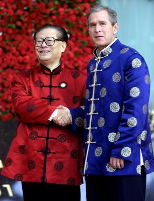 Bush with a Chinese diplomant (prime minister?).