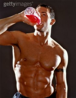 Hunky guy with tat drinking juice drink. (C) Getty Images
