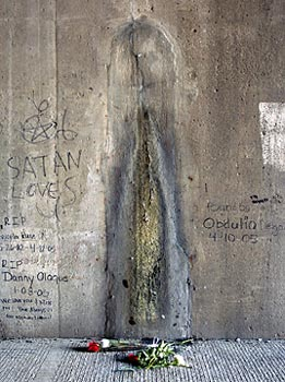 Virgin Mary appearing as salt runoff in Chicago underpass.