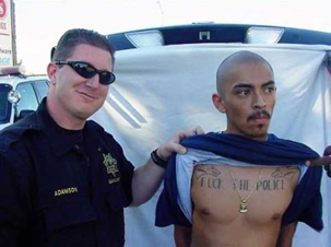 Guy getting arrested with Fuck The Police tat on his chest.