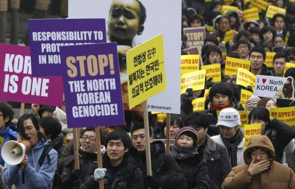 South Korean Christians and former North Korean defectors living in the South march during a rally to protest against what they say is North Korea's violation of human rights, in Seoul