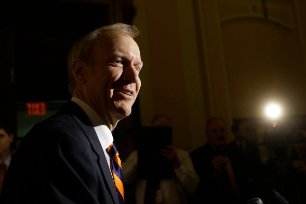 Republican Illinois Gov.-elect Bruce Rauner speaks to reporters the Illinois State Capitol Tuesday, Dec. 2, 2014, in Springfield Ill. Rauner is visiting the statehouse as House Democrats push to gather votes for a statewide wage hike. Rauner is meeting with lawmakers and budget experts to get a better handle on the budget situation. (AP Photo/Seth Perlman)